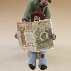 Homme lecture en douce santons arlatenco